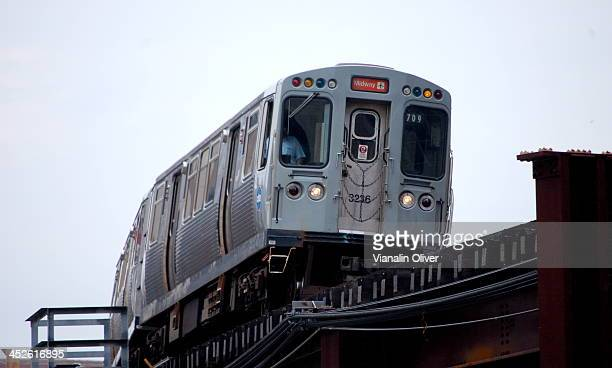 Front image of an approaching Chicago L train on the elevated tracks.