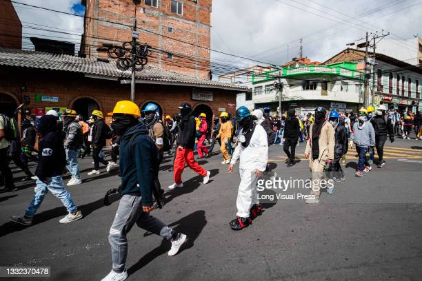 Front Line demonstrators march as demonstrations ended in late-night clashes between riot police and Demonstrators as Colombia marks 3 months of...