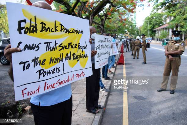 Front Line socialist party members hold a placard during a protest against the port city Act in front of the Supreme Court in Colombo, Sri Lanka...