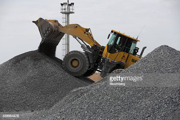 A front loader arranges storage piles of gold bearing ore at the Suzdal gold mine operated by Nordgold NV in Semey Kazakhstan on Wednesday June 8...