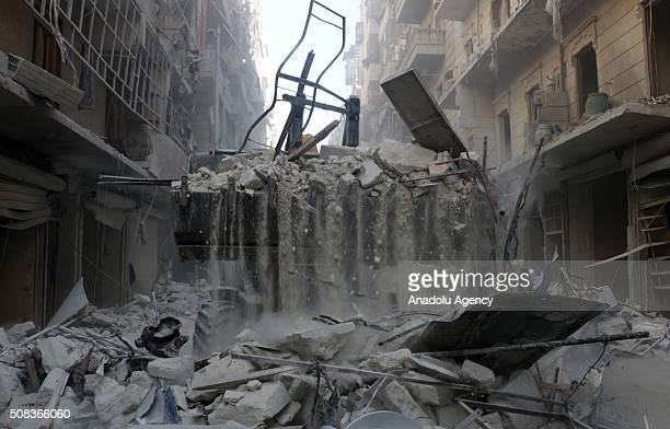 A front loader removes rubble at the site after the war crafts belonging to the Russian army carried out airstrikes on opposition controlled...
