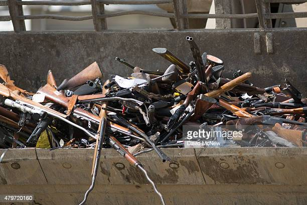 A front loader tractor carries guns to the melt shop during the destruction of approximately 3400 guns and other weapons at the Los Angeles County...
