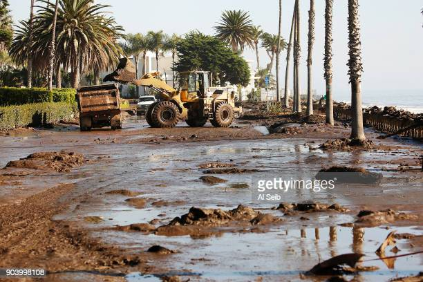Front loaders begins cleanup on Channel Drive in front of the Four Seasons Biltmore January 11 2018 after a rainstorm sent mud and debris through...