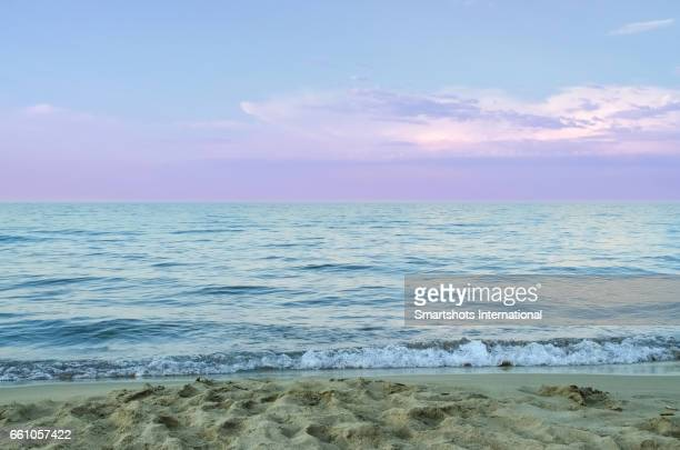 Front low angle view of Mediterranean sea beach in wintertime is Spain