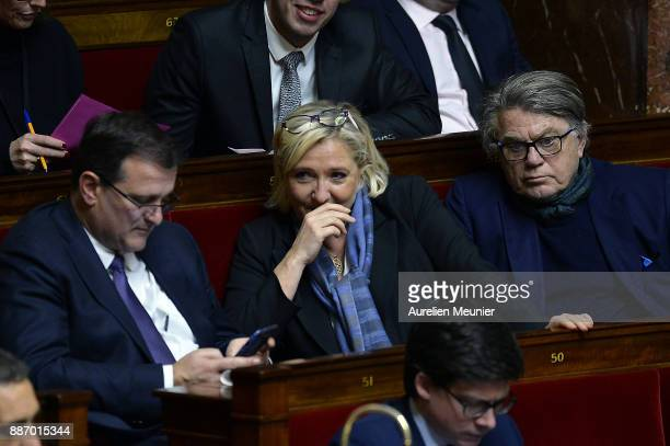 Front National President Marine Le Pen and Front National Louis Alliot and Gilbert Collard react as Ministers answer deputies questions during the...
