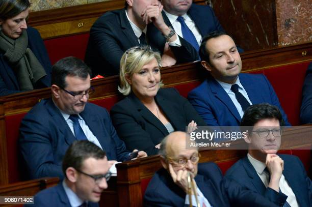 Front National Vice President Louis Alliot Front National President Marine Le Pen and Front National Deputy Sebastien Chenu react as Ministers answer...