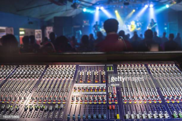 Front of house soundboard at rock gig