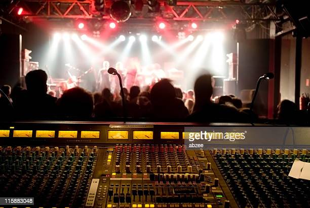 Front of house soundboard with band on stage