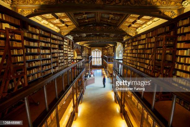 Front of House Visitor Host Jessica Baudet wears protective mask and shield as she stands in the Duke Humphrey's Library at the Bodleian Libraries on...