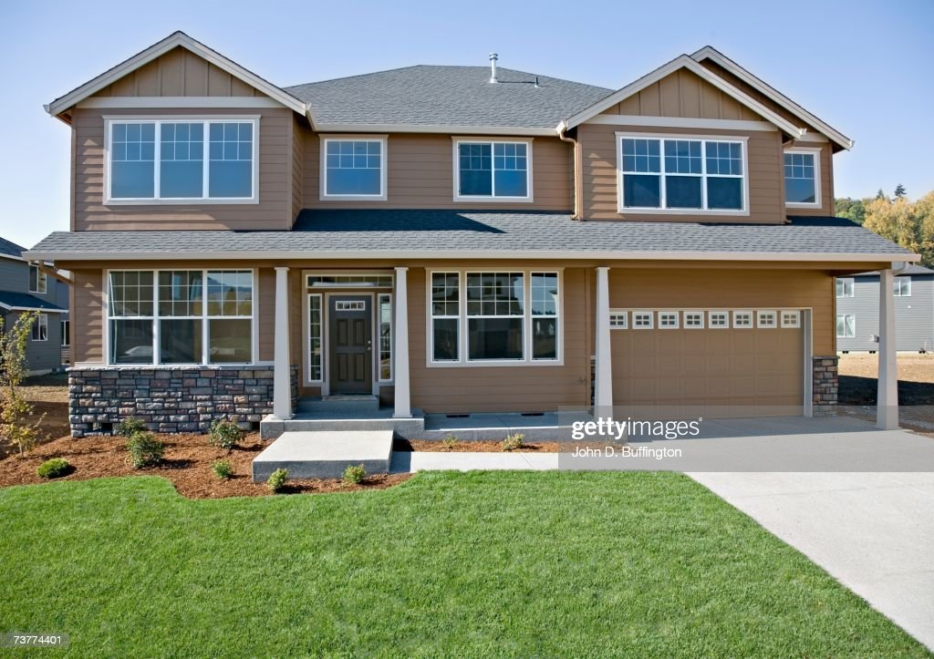 Front Of House With Lawn And Driveway Stock Photo Getty