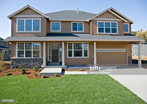 front of house with lawn and driveway - facade stock pictures, royalty-free photos & images