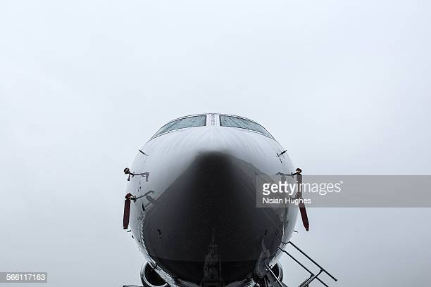 front of private jet, airplane in the rain