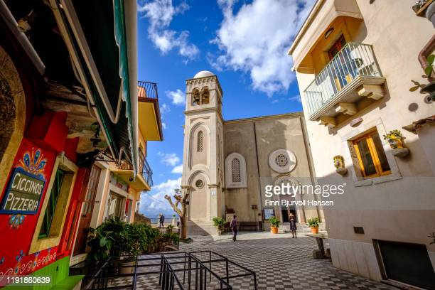castelmola, taormina, italy - november 8, 2019: front of the church of san giorgio, pizzeria on the left side - finn bjurvoll stock pictures, royalty-free photos & images