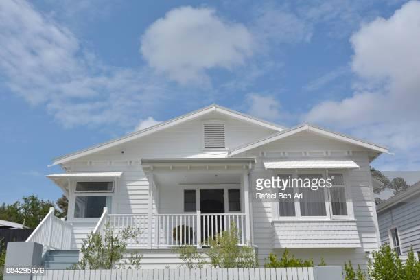 front of traditional bungalow house low angle view - rafael ben ari stock-fotos und bilder
