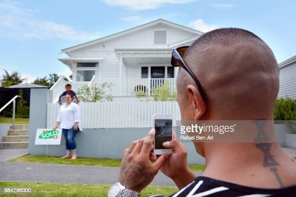 front of traditional bungalow house - rafael ben ari stockfoto's en -beelden