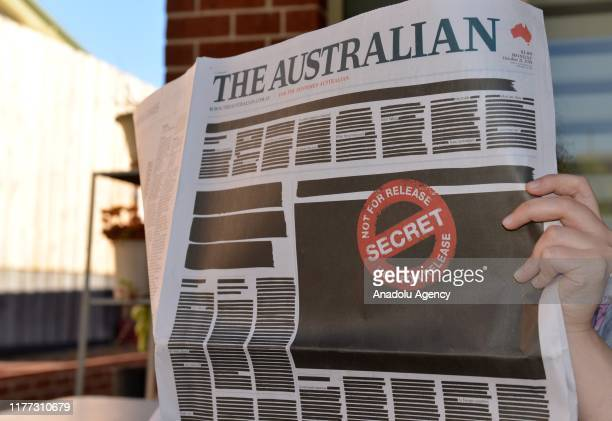 Front page of The Australian newspaper is seen on October 21, 2019 in Melbourne, Australia. Front page of every newspaper across Australia was...