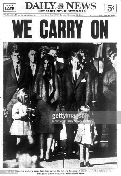 Front page of the Daily News dated Nov 26 Headline WE CARRY ON John F Kennedy Jr salutes his father's casket as he stands with his mother Jacqueline...