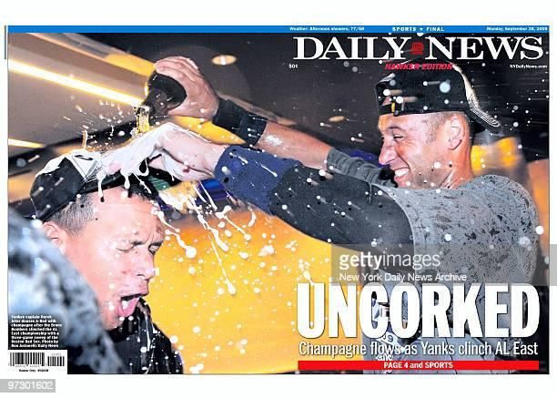 Front page of the Daily News for September 28 headline Uncorked Champagne flows as Yanks clinch AL East photo of Derek Jeter giving Alex Rodriguez a...