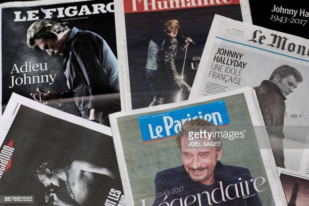 Front pages of French newspapers in tribute to late French singer Johnny Hallyday are displayed in Paris on December 7 2017 French music icon Johnny...