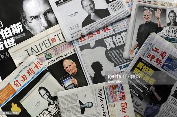 Front pages of local newspapers showing stories on the late Steve Jobs are seen on display in Taipei on October 7 2011 Major Apple supplier Foxconn a...