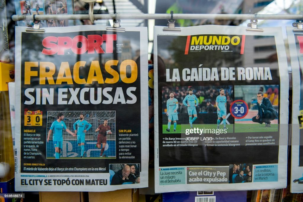 Front pages of sports newspapers are displayed at a kiosk in ...