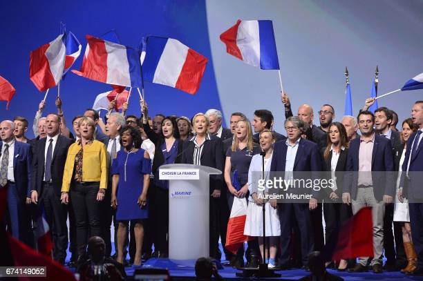 Front Party Leader and Presidential Candidate Marine Le Pen salutes the crowd after a political meeting on April 27 2017 in Nice France Le Pen is...
