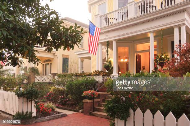 front porch and gardens with american flag - south stock pictures, royalty-free photos & images