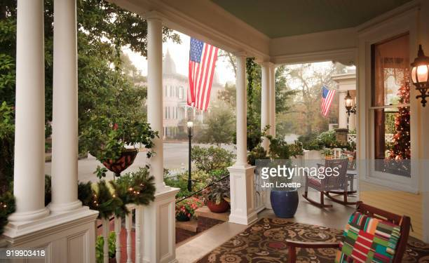 Front Porch and gardens with American Flag