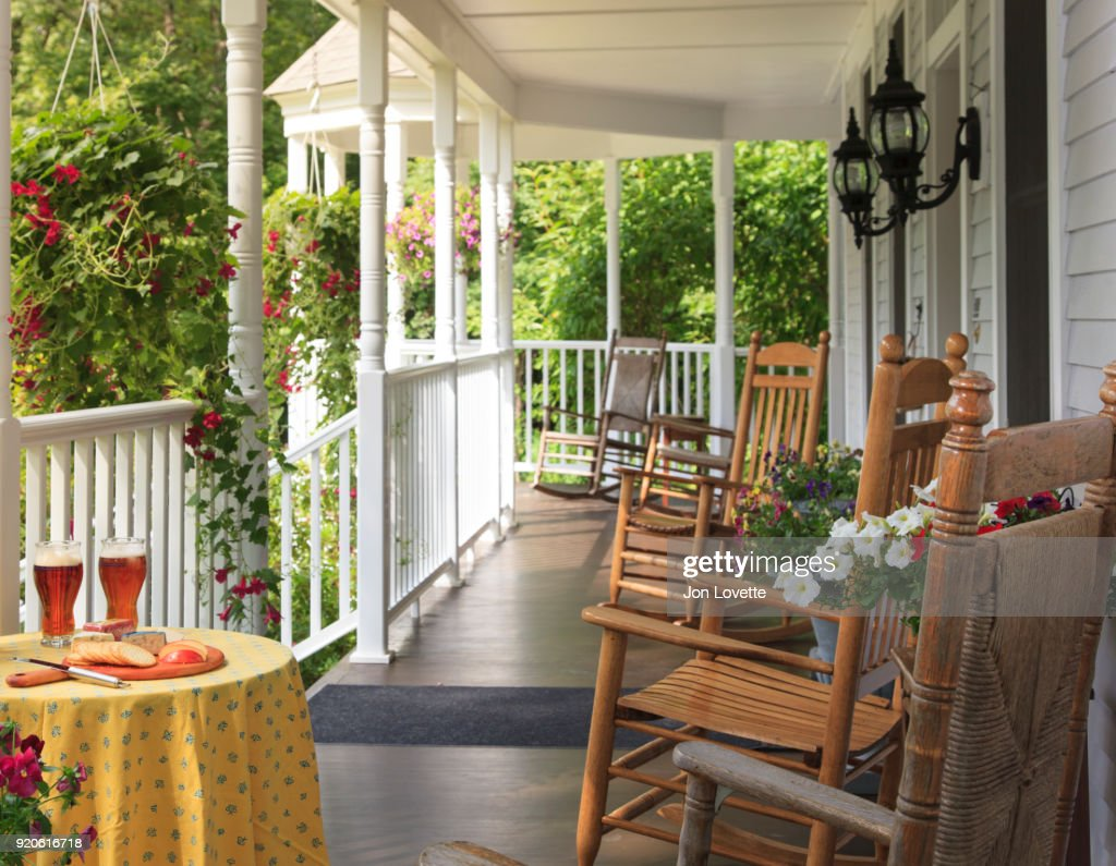 Front Porch In Summer With Rocking Chairs And Beer Stock Photo