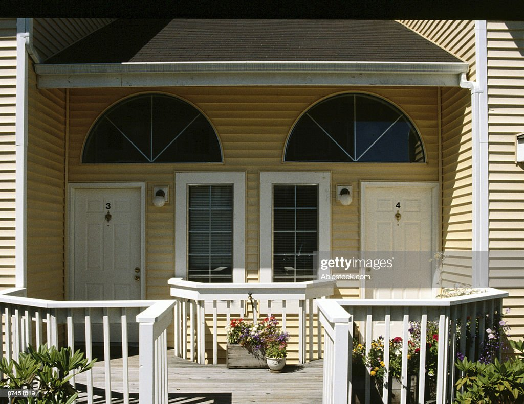 Front porch of a duplex house : Stock Photo