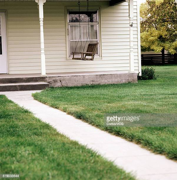 Front porch of a house and a swinging chair