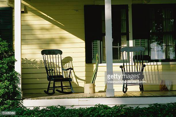 Front porch of house with rocking chairs
