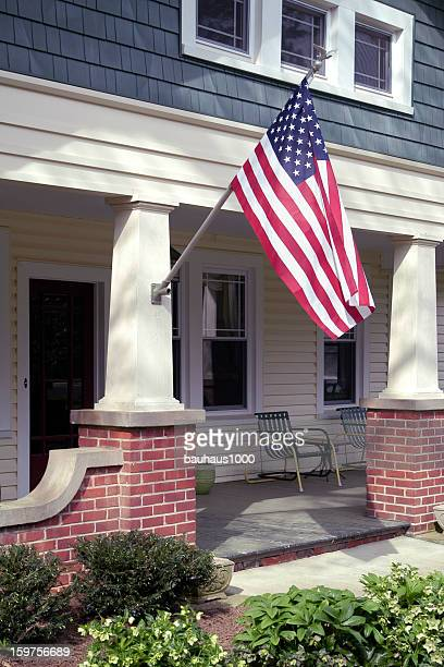 front porch with an american flag - flag day stock pictures, royalty-free photos & images