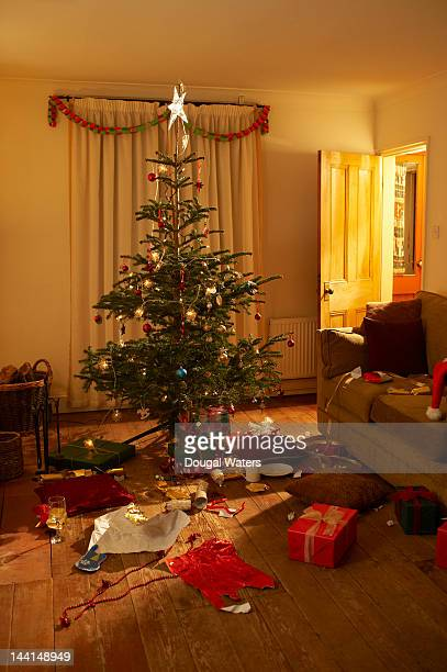 front room at christmas with open presents. - after party mess stock pictures, royalty-free photos & images