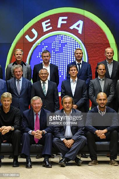Arsenal's manager Arsene Wenger Manchester United's manager Alex Ferguson UEFA president Michel Platini and Barcelona's coach Josep Guardiola 2nd row...