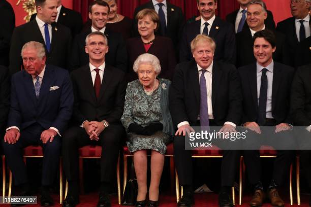 front row Britain's Prince Charles Prince of Wales NATO Secretary General Jens Stoltenberg Britain's Queen Elizabeth II Britain's Prime Minister...