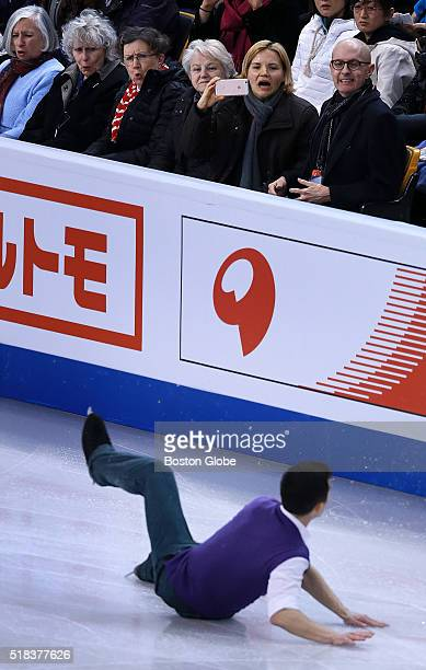 Front row fans react as Patrick Chan of Canada falls during the Men's Short Program competition of the World Figure Skating Championships at TD...
