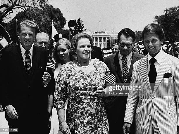 Front row from left American evangelical preacher Billy Graham singer Kate Smith Dr E Harrison and singer Pat Boone celebrate 'Honor America Day' on...