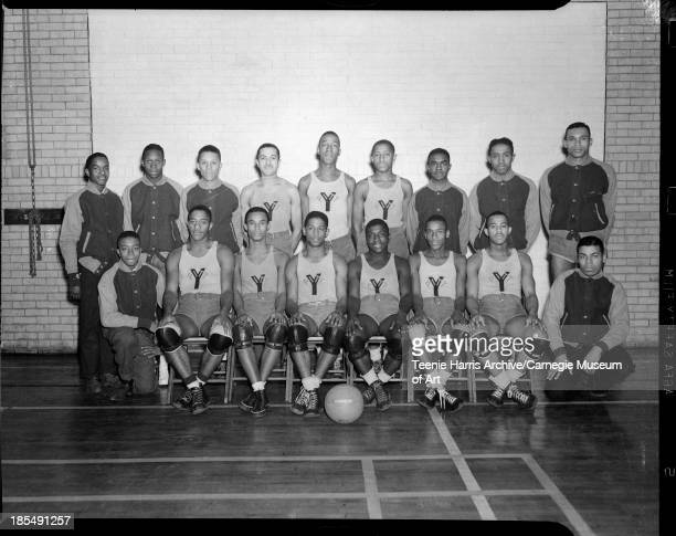 Group portrait of Centre Avenue YMCA Big Five basketball team posed in gymnasium Pittsburgh Pennsylvania November December 1939 Front row from left...