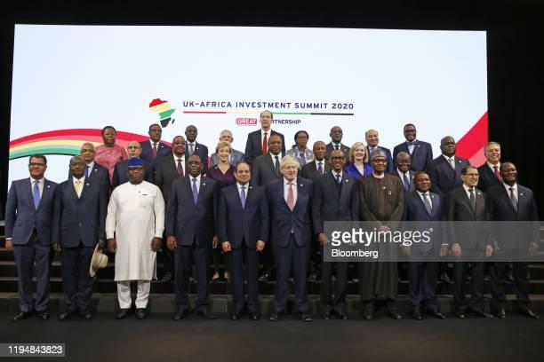 Front row, from left to right, Alok Sharma, U.K. Minister for international development, Yoweri Museveni, Uganda's president, Julius Maada, Sierra...