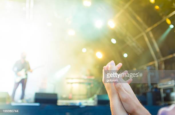 Front row in a concert,  motion blur