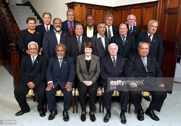 Front row left to right Premier Young Vivian of Niue Prime Minister Rt Hon Sir Michael Somare of Papua New Guinea Prime Minister Rt Hon Helen Clarkof...