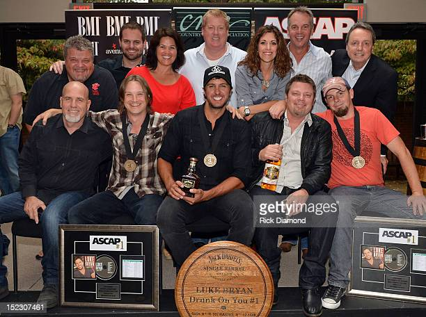 front row producer Jeff Stevens cowriter Josh Kear Luke Bryan and cowriters Rodney Clawson and Chris Tompkins back row Big Red Toe Music's Craig...