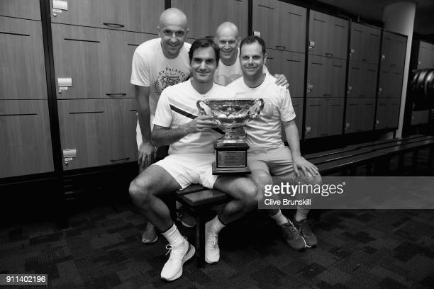 LR Front Row Roger Federer of Switzerland Severin Luthicoach Back Row LR Ivan Ljubicic coachDaniel Troxler physio and Tony Godsickagent pose with the...