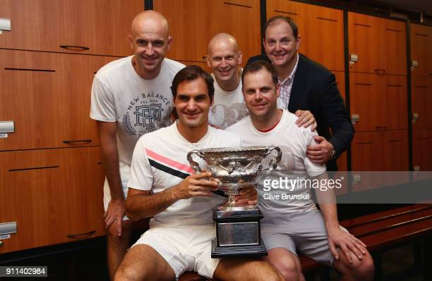 Front Row Roger Federer of Switzerland Severin Luthicoach Back Row LR Ivan Ljubicic coachDaniel Troxler physio and Tony Godsickagent pose with the...