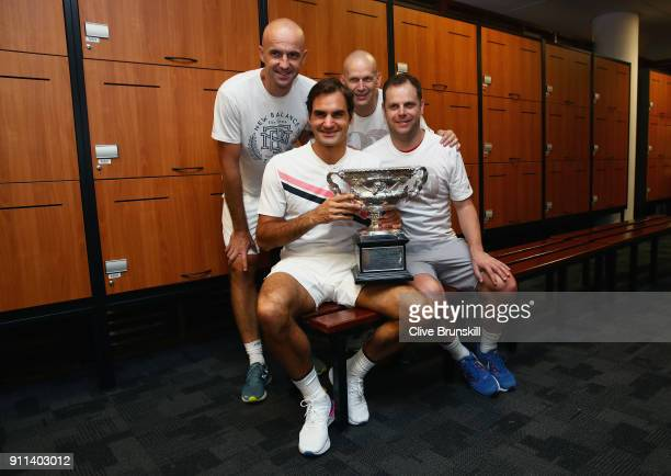 Front Row Roger Federer of Switzerland Severin Luthicoach Back Row LR Ivan Ljubicic coachDaniel Troxler physio pose with the Norman Brookes Challenge...