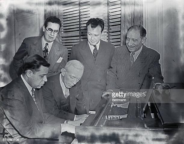 1/12/1943 Front row sitting at piano Oscar Levant and John Kieron back row Dan Golenpaul Clifton Fadiman and Franklin P Adams