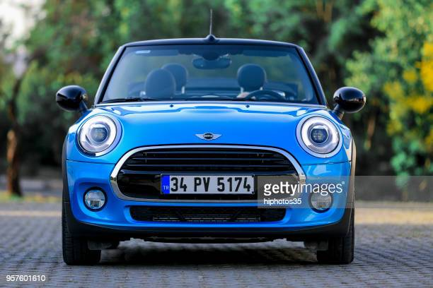 front side view of a mint condition blue  mini cooper s with black leather interior parked in gaziemir district of izmir - mini cooper stock pictures, royalty-free photos & images
