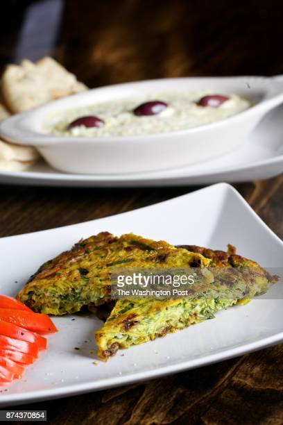 Kuku SabziFresh herbs frittata with barberries and walnut and Salad OliviehPersian style chicken potato salad with peas and pickles at Library Tavern...