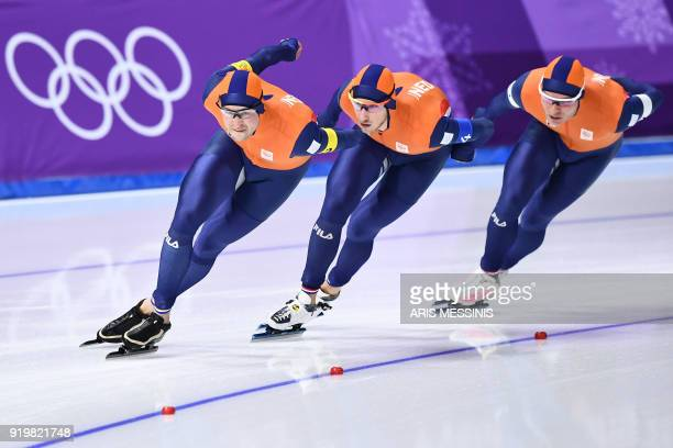 Netherlands' Sven Kramer Netherlands' Jan Blokhuijsen and Netherlands' Koen Verweij compete in the men's team pursuit quarterfinal speed skating...